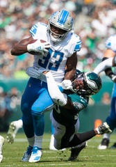 Detroit Lions' Kerryon Johnson runs as Philadelphia Eagles' Rodney McLeod tries to tackle him Sunday, Sept. 22, 2019 at Lincoln Financial Field.