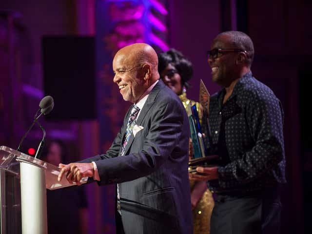 Berry Gordy addresses a crowd at Detroit's Orchestra Hall on Sept. 15, 2019, as director Lee Daniels holds Gordy's Motown Legacy Award.