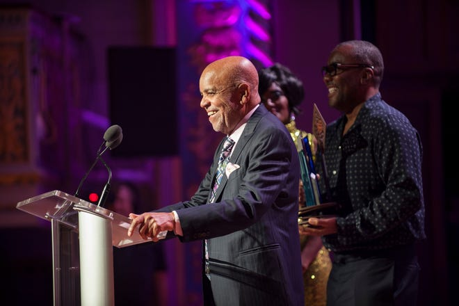 Berry Gordy addresses a crowd at Detroit's Orchestra Hall on Sunday night as director Lee Daniels holds Gordy's Motown Legacy Award.
