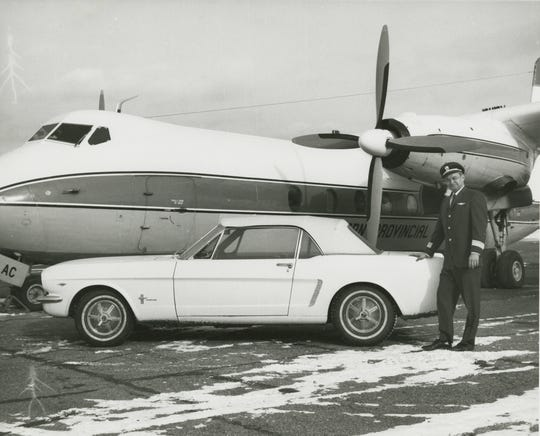 Ford Mustang Serial Number 1 and the original owner, Captain Stanley Tucker in 1966.