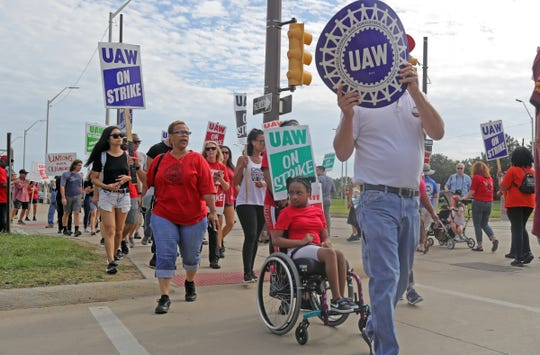 UAW workers on the picket line in front of the Detroit Hamtramck Assembly plant Sunday, September 22, 2019 in Detroit, Mich.