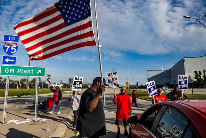 D'Andre Jackson, 43, of Flint walks up to a vehicle trying to enter the General Motors Flint Assembly Plant to ask for an employee ID on the fourth day of the UAW nationwide strike  after stalled contract talks with General Motors in Flint, Mich. on Thursday, Sept. 19, 2019.