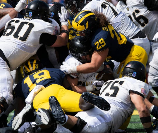 Michigan linebacker Jordan Glasgow (29) says the Wolverines aren't focusing on the outside criticism of the team.