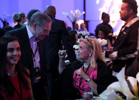 U.S. Rep. Debbie Dingell, right, talks with Ralph Gerson of the William Davidson Foundation, left, at the dinner.