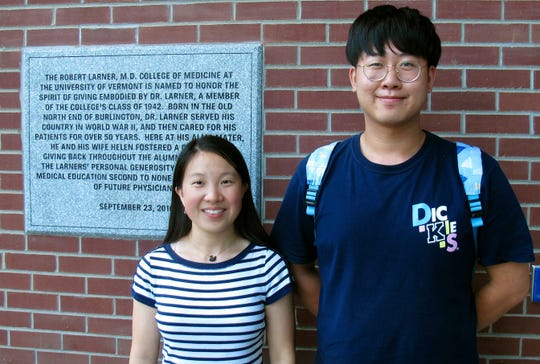 Chinese graduate students Zhaojin Li, left, and Pengfei Liu, in front of the entrance to the Robert Larner College of Medicine at the University of Vermont in Burlington, Vt.