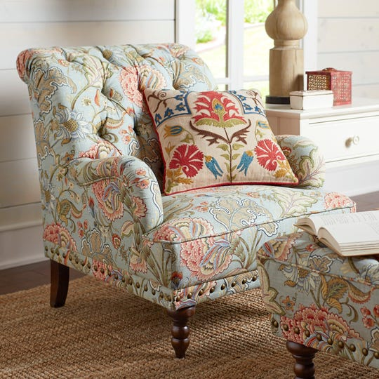 A comfy armchair and ottoman with floral fabric bring the outdoors in year-round. Mix a pillow with a different pattern to make the pieces pop.