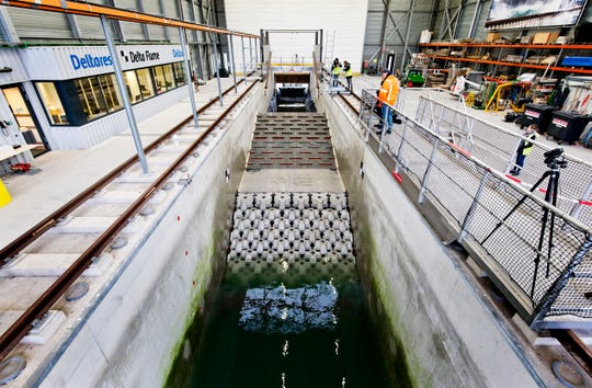 This photo taken in Jan. 2019 and made available by Deltares shows the flume wave tank in Delft, Netherlands, that is used to test structure designs for the strengthening work for the Afsluitdijk.