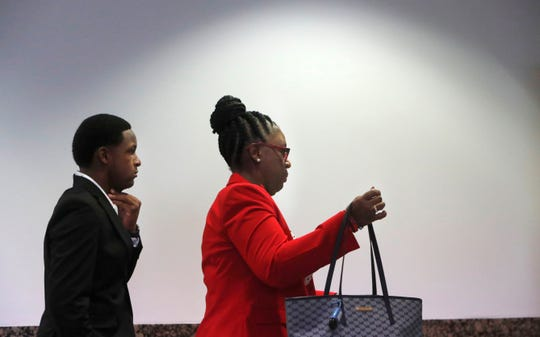 Allison Jean, right, the mother of Botham Jean and Botham's brother Brandt Jean arrive for the murder trial of former Dallas police Officer Amber Guyger in Dallas, Monday, Sept. 23, 2019.