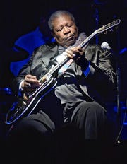 This June 20, 2002 file photo shows blues legend B.B. King performing at the second anniversary celebration of B.B. King's Blues Club and Grill in New York. A guitar given to B.B. King for his 80th birthday has sold for $280,000 at an auction of items from the blues legend's estate.