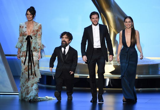 "Lena Headey, from left, Peter Dinklage, Kit Harington and Emilia Clarke, of the cast of ""Game of Thrones,"" appear on stage to present the award for outstanding supporting actress in a limited series or movie at the 71st Primetime Emmy Awards on Sunday, Sept. 22, 2019, at the Microsoft Theater in Los Angeles. (Photo by Chris Pizzello/Invision/AP)"
