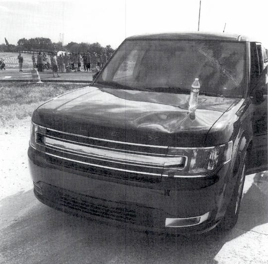 A photo of an SUV with a dented hood and  cracked windshield was submitted to a judge in Tennessee by GM as part of a complaint about damage done by striking workers at the Spring Hill Assembly Plant.  The judge issued a temporary restraining order to prevent strikers from blocking access to the facility.
