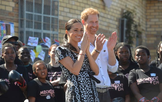 Britain's royal couple Prince Harry and Meghan Duchess of Sussex, greet youths on a visit to the Nyanga Methodist Church in Cape Town, South Africa.