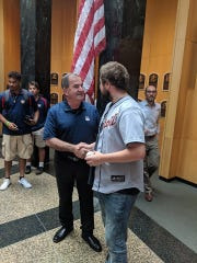Ely Hydes greets Tim Mead, president of the Baseball Hall of Fame.
