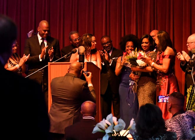 At the dinner, the board members surprise Robin Terry, chairwoman and CEO of the Motown Museum, with flowers and a thank you for all of her work.