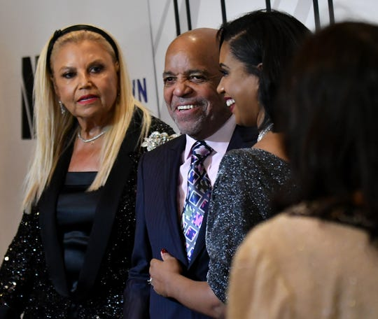 Robin Terry, chairwoman and CEO of the Motown Museum, right, hugs Motown Record founder Berry Gordy, with Suzanne De Passe, left, as they enter on the red carpet. Hitsville Honors event at The Cube at Orchestra Hall in Detroit on Sept. 22, 2019.  
