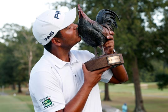 Sebastian Munoz kisses the trophy after winning the Sanderson Farms Championship in Jackson, Mississippi, on Sunday.