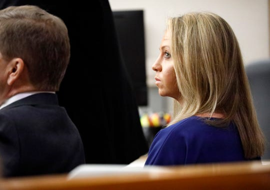 Former Dallas police Officer Amber Guyger listens to pretrial arguments in Judge Tammy Kemp's 204th District Court in Dallas, Monday, September 23, 2019.