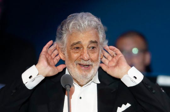In this Aug. 28, 2019 file photo, opera star Placido Domingo listens to applause at the end of a concert in Szeged, Hungary, Wednesday, Aug. 28, 2019.