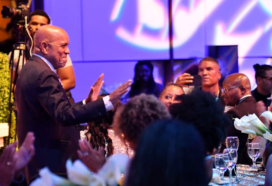Berry Gordy acknowledges applause for him after he is mentioned in remarks at the dinner.