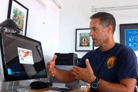"Ecologist Greg Asner, the director of Arizona State University's Center for Global Discovery and Conservation Science, reviews ocean temperature data at his lab on the west coast of the Big Island near Captain Cook, Hawaii. ""Nearly every species that we monitor has at least some bleaching,"" said Asner after a dive in Papa Bay."