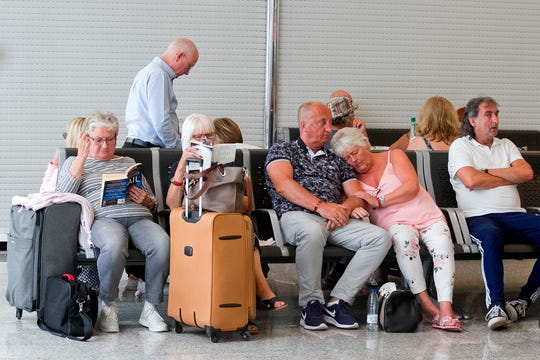 British passengers wait for news on cancelled Thomas Cook flights at Palma de Mallorca airport on Monday.
