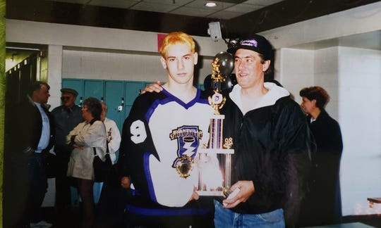 Mike Hoon Sr. (right) poses with his son Matt after a championship victory for the Evansville Thunder in 1998.