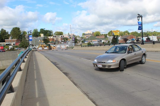 Vehicles were forced to turn around Monday at the State Street Bridge as Norfolk Southern replaces tracks.