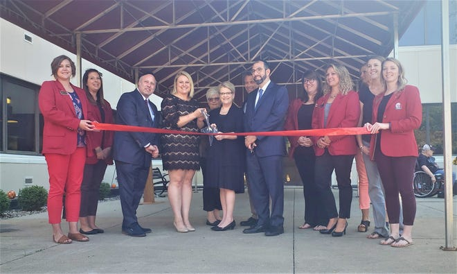 The Sandusky County Chamber Ambassadors with city and county officials helped to celebrate the renovations at Countryside Manor.