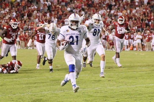 Sep 21, 2019; Fayetteville, AR, USA; San Jose State Spartans running back DeJon Packer (21) rushes for a touchdown against the Arkansas Razorbacks in the fourth quarter at Donald W. Reynolds Razorback Stadium. Mandatory Credit: Nelson Chenault-USA TODAY Sports