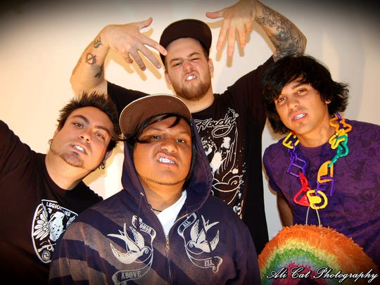 A 2009 photo of local pop-punk band The Absentee Ballot. Pictured, from left, are Joe Hill, José Garzón, Derek Doucette and Shane Frank.