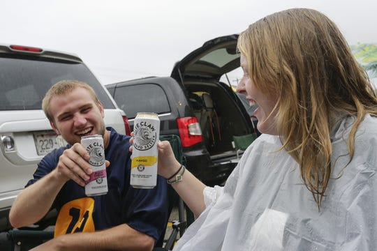 Zach Mock and Molly Schwibinger, of Sheboygan, share a toast with hard seltzer drinks before the Green Bay Packers and Denver Broncos football game Sunday at Lambeau Field. Joshua Clark/USA TODAY NETWORK-Wis.