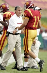 Pete Carroll, left, had seven consecutive 10-win and twice won national titles at Southern Cal; since he left after the 2009 season, the Trojans have had four head coaches.