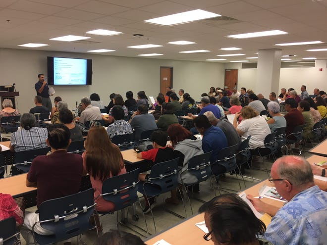 Dozens of government of Guam retiirees attend the first presentation on the government's new health insurance plan from Aetna International at the Department of Education in Tiyan in this Sept. 23, 2019, file photo.