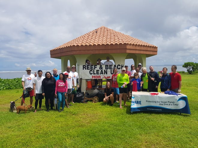 The Micronesian Divers Association team participated in the annual Coastal Cleanup held on Sept. 21. Pictured with the dive team is debris they brought to the surface.