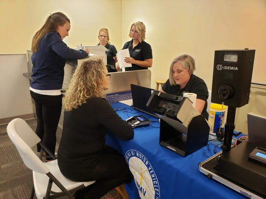 Airport employees apply to get their Real ID on Monday, Sept. 23, 2019 at the Indianapolis International Airport.