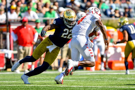 New Mexico Lobos quarterback Sheriron Jones (4) is tackled by Notre Dame Fighting Irish linebacker Asmar Bilal (22) in the second quarter at Notre Dame Stadium.