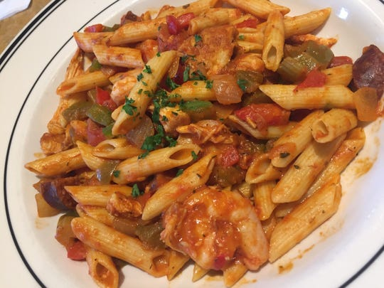 Mimi's Bistro & Bakery French creole pasta features shrimp, chicken, Andouille sausage, red and green peppers and onions over penne pasta.