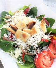 Pizza and Amore's spinach salad topped with freshly grated parmesan and naan croutons.