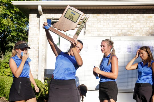 Harrison players celebrate after placing first in the IHSAA girls golf Sectional #5, Monday, Sept. 23, 2019 at Coyote Crossing Golf Course in West Lafayette.