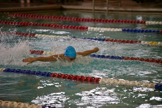 Ascension Episcopal's Ashley Gill returns to the Lady Blue Gators' swim team after winning both the Division IV 100 freestyle and 100 backstroke state championships last year.