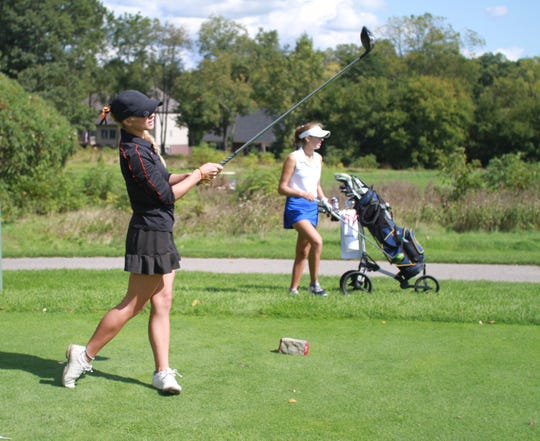 Brighton's Maggie Pietila watches her drive on No. 14 during the Coach Miller Invitational at Oak Pointe Country Club on Monday, Sept. 23, 2019.