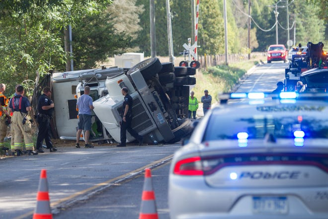 A semi truck hauling dirt rolled over on westbound Bishop Lake Road just east of Chilson Road in Hamburg Twp. Monday, Sept. 23, 2019, blocking the road.