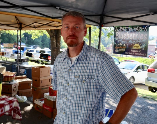 Shad Baker sells blueberries from a farm on a reclaimed strip mine at the Whitesburg farmers market this summer.