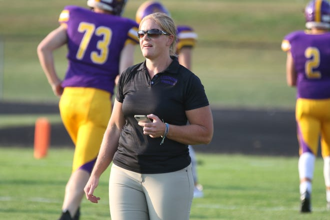 Lexington strength and conditioning coach Emily Patterson is paving a way for women in high school football.