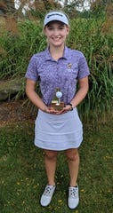 Lexington sophomore Lainey Kathrein scored a hole-in-one on a par 4 at Brookside Golf Course in Ashland on Saturday, helping her team to a runner-up finish behind Ashland in the North Central Ohio Girls Golf League Tournament.
