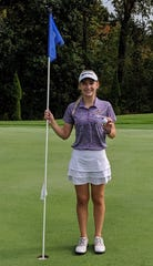Lexington sophomore Lainey Kathrein on the green of the par 4, 264-yard No. 18 at Brookside Golf Course in Ashland, where she had a hole-in-one, or double eagle, on Saturday during the North Central Ohio Girls Golf League tournament.