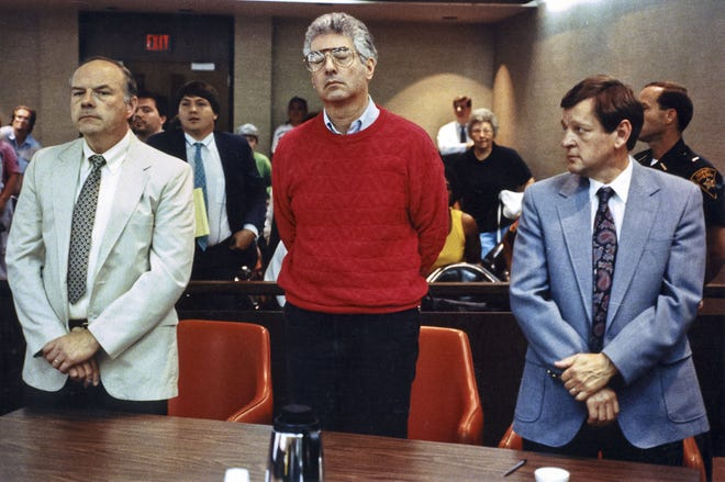 Dr. John Boyle, center, was sentenced to life in prison for the aggravated murder of his wife Noreen in 1990. Attorneys Robert Whitney and Charles Robinson represented him.