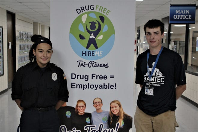 Tri-Rivers Career Center seniors Kristina Lee, left, and Max Russell are members of the school's Drug Free/Hire Me Club. Students involved in the club make a commitment to maintain a drug-free lifestyle. According to Tri-Rivers officials, 280 students, about half of the school's enrollment, are members of the Drug Free/Hire Me Club this academic year.