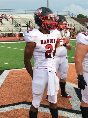 Marion Harding's DeAndre Ayers watched the coin toss in the season-opening game at Mount Vernon.