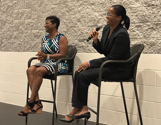 Lisa Lee (left) and Nikki McCray-Penson (right) discuss memories as former teammates at the inaugural Collierville High School Alumni Association scholarship fundraiser.